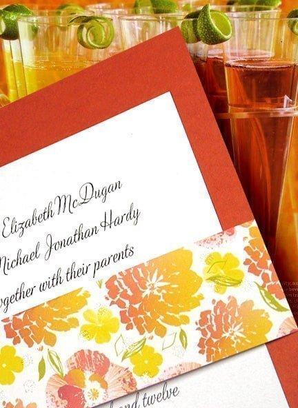 orange invitation with floral sash