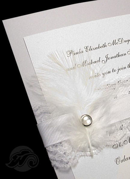 Luxe wedding invitations using feathers, lace and pearl brad