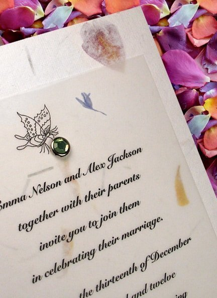 Lovely Garden Petal Paper Wedding Invitations and Green Crystal Brad